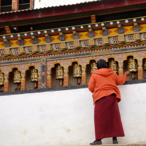 Monk spins prayer wheels at monastery in the outskirts of Thimphu, the capital of Bhutan