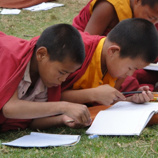 "Young Buddhist monks learning English by the Chimi Khakhang, the monastery of the ""Divine Madman."" Punakha, Bhutan"
