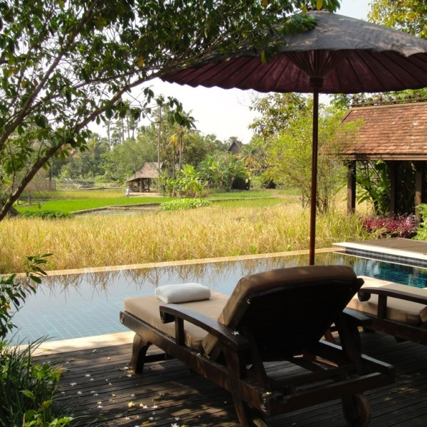 Private in-villa pool overlooking he rice fields at The Dhara Dhevi. Chiang Mai, Thailand